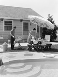 1960s Summer Outdoor Family of Four Backyard Barbeque by Pool Photographic Print