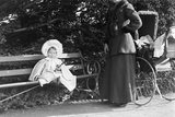 Toddler with Nanny or Mother on a Park Bench, Ca. 1900 Photographic Print