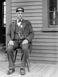 Station Master Sits at the Train Depot, Ca. 1900 Photographic Print