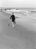 Woman Walking on Beach Leaving Footprints Photographic Print by Philip Gendreau