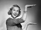 1950s-1960s Happy Smiling Blond Woman Gesturing with Hands Showing Size of Something Photographic Print