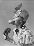 1930s-1940s Girl Bobbing for Apple Dangling on a String Wearing Party Hat and Holding Eye Mask Photographic Print