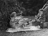 1940s Boy and Girl Having Summer Picnic Photographic Print