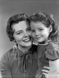 1950s Girl Daughter Smiling Hugging Woman Mother Cheek to Cheek Together Photographic Print