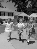 1960s 3 Kids Walking Skipping Running on Suburban Sidewalk Photographic Print