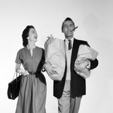 1950s Couple Walking Woman Smiling at Man Carrying Grocery Bags Smoking Cigar Photographic Print