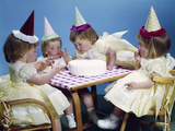 1950s-1960s Quadruplets 4 Red Haired Girls Wearing Party Hats and Dresses Sitting at Table Photographic Print