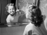 1950s Girl Looking in Bathroom Mirror Brushing Teeth Reproduction photographique