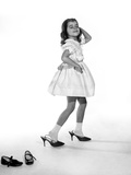 1960s Girl Making Glamour Pose Having Stepped Out of Her Shoes into Her Mothers Adult High Heels Photographic Print