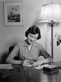 1940s-1950s Woman Sitting at Desk Writing Letters Doing Correspondence Photographic Print