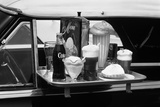 Food Tray with Soda Fountain Items on Car Window at 1950s Style Drive-In Restaurant Photographic Print by Hub Willson