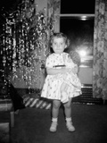 A Little Girl Stands Photographic Print