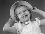1950s Child Smiling Little Girl Wearing Pretty Dress and Straw Hat Photographic Print