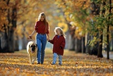 Mother and Child Walking Dog in Autumn Photographic Print
