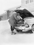 1950s Man Winter Driveway Trying to Start Fix Car Hood Up Photographic Print