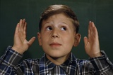 Boy Holding Out Hands Photographic Print by William P. Gottlieb