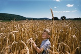Boy Standing in Field of Wheat Photographic Print by William Gottlieb