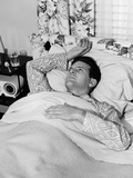 1940s-1950s Sick Man in Bed in Pajamas One Hand on Chest One Above His Head on Pillow Photographic Print