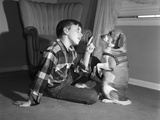 1950s Boy in Plaid Shirt Shaking Finger at Dog Sitting Up on Rear Legs Photographic Print
