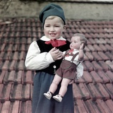 Four Year Old German Boy Stands with His Lederhosen Dressed Doll, Ca. 1949 Photographic Print
