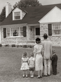 1950s Family of Five with Backs to Camera on Lawn Looking at Fieldstone House Photographic Print