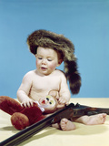 1960s Baby Boy Wearing Coonskin Cap with Stuffed Animal and Shotgun Photographic Print