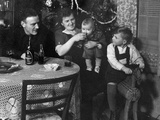 One Year Old Baby Boy Gets a Drink of Coca Cola in Front of the Christmas Tree, Ca. 1946 Reprodukcja zdjęcia