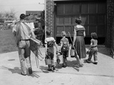 1950s Family Mother Father 3 Children from Behind Carrying Gardening Home Improvement Tools Photographic Print