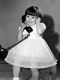 Young Girl Talks on the Phone, Ca. 1962 Photographic Print