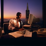 1980s African-American Executive Working at Computer after Hours Photographic Print