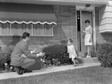 1960s-1970s Little Girl Running to Greet Father on Sidewalk Mother at Front Door Photographic Print