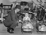 1950s Father in Toy Store Purchasing for Son Driving Toy Convertible Peddle Car Photographic Print