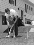 1960s Father and Young Daughter Playing Croquet in Yard Photographic Print