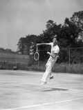 1930s Man Playing Tennis Jumping Mid Air Action Fotografiskt tryck