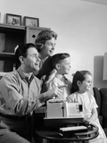 1960s Happy Family Looking at Slides on Slide Projector Photographie