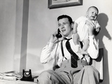 1950s Father Holding Baby While on the Phone Photographic Print