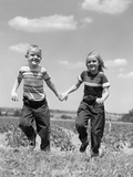 1950s Boy Girl Running Grassy Farm Field Holding Hands Photographic Print