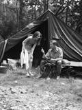 1920s Camping Couple Man Sitting by Tent with Fishing Rod Woman Standing Wearing Bathing Suit Photographic Print