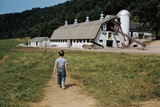 Boy Walking Towards a Barn Photographic Print by William P. Gottlieb