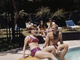 1960s Four People on Patio Couple Man Woman Sitting on Edge of Swimming Pool Photographic Print