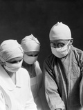1920s-1930s Doctor and Two Nurses Wearing Surgical Masks Photographic Print