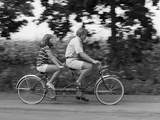 1970s Teenage Girl and Boy Riding Bicycle Built for Two Papier Photo