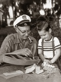 1950s-1960s Young Boy with Smiling Grandfather Building Model Boat Photographic Print
