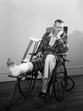 1950s Man in Wheelchair Leg in Cast with Crutches at Side Photographic Print