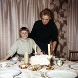 Nine Year Old Girl Is About to Blow Out the Candles on Her While Her Mom Watches, Ca. 1962 Photographic Print