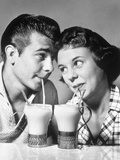1940s-1950s Romantic Teenage Couple Boy and Girl Head to Head Drinking Ice Cream Sodas Photographic Print