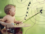 1960s Baby in High Chair Using Wooden Pointer to Indicate Low Pressure Area on Weather Map Photographic Print