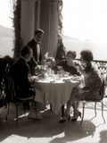 1920s Group Eating on Balcony with Waiter Serving Wine Photographic Print