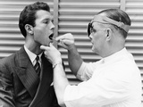 1930s-1940s Doctor Examining Throat of a Young Man Photographic Print