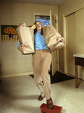 1970s Woman Holding Grocery Bags Falling Stepping on a Toy Photographic Print